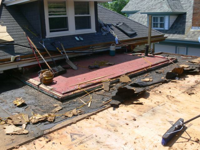 Demolition Of A Flat Roof In Preparation For Roofing With